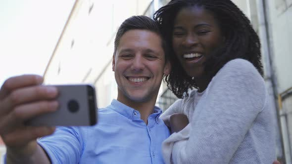 Thumbnail for Happy Young Multiracial Couple Posing for Selfie Outdoor
