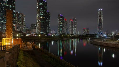 Timelapse Illuminated Incheon Skyscrapers at Harbour