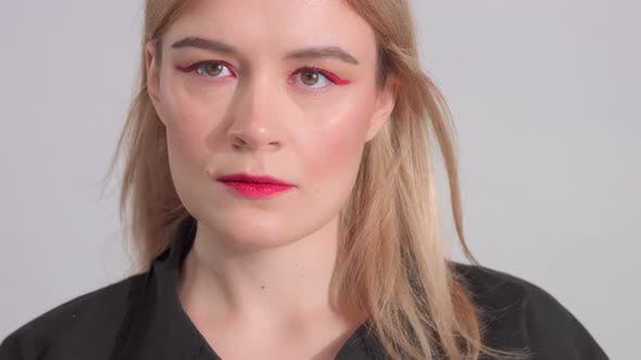 Thumbnail for Blonde Woman with Bright Red Makeup in Studio