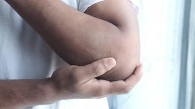 Man with Elbow Pain Pain Relief Concept