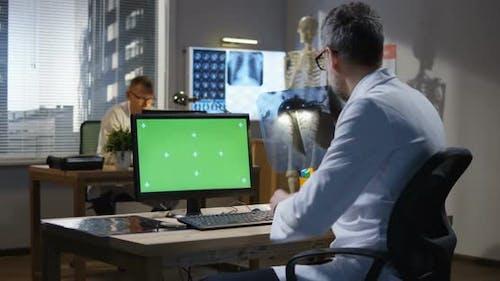 Doctor Analyzing X Ray
