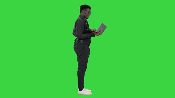 Thumbnail for Confident African American Businessman Typing on Laptop on a Green Screen, Chroma Key
