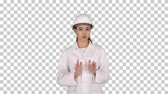 Thumbnail for Female Engineer Walking and Talking to Camera Presenting Something