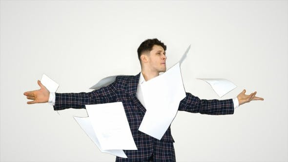 Thumbnail for Businessman throws up documents and dances happy on gradient