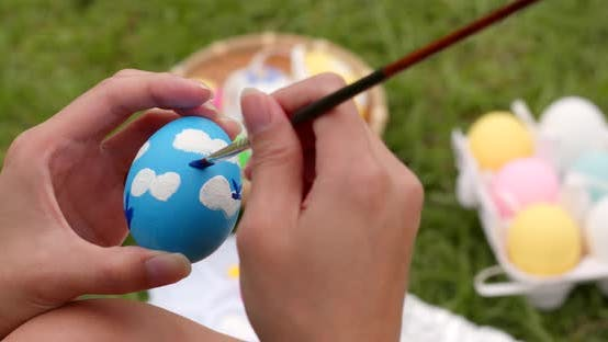 Thumbnail for Drawing on egg for Easter holiday at outdoor
