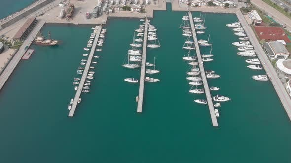 Luxury yachts and sailboats are moored in marina at blue lagoon