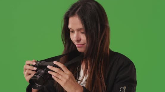 Thumbnail for Pretty photography student taking pictures with digital camera on greenscreen