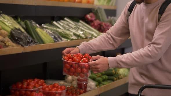 Multiethnic Buyers Choosing Tomatoes in Farm Shop