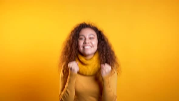 Thumbnail for Girl with Curly Hair Very Glad and Happy, She Shows Yes Gesture of Victory