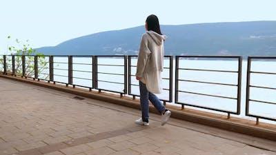 Slim Beauty Walks on Bridge