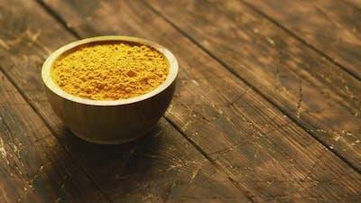 Small Bowl of Orange Turmeric Spice