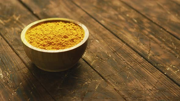 Thumbnail for Small Bowl of Orange Turmeric Spice