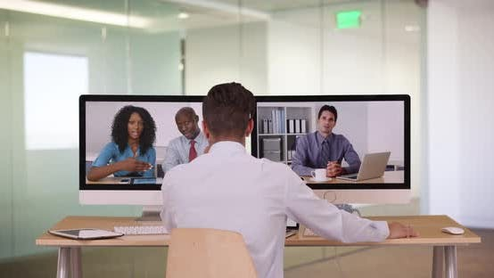Thumbnail for Diverse group of business associates having internet based web conference over video chat