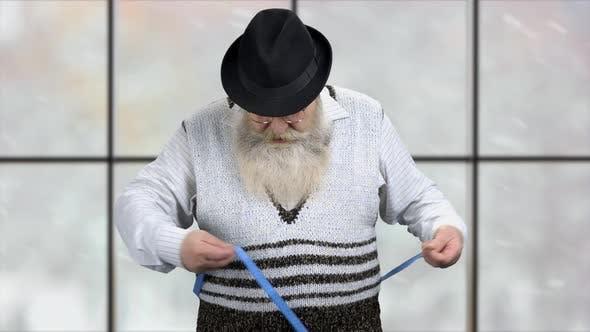 Obese Senior Man Measuring His Belly