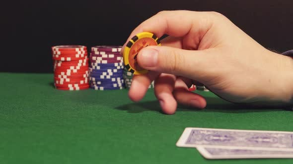 Thumbnail for Poker: Player Twirls A Playing Chip In The Hand And Thinks