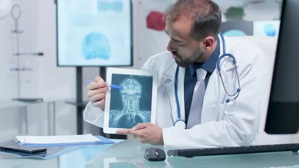 Thumbnail for Doctor Showing a X Ray Scan on a Digital Tablet PC