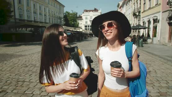 Cover Image for Friends Drinking Coffee Outdoors