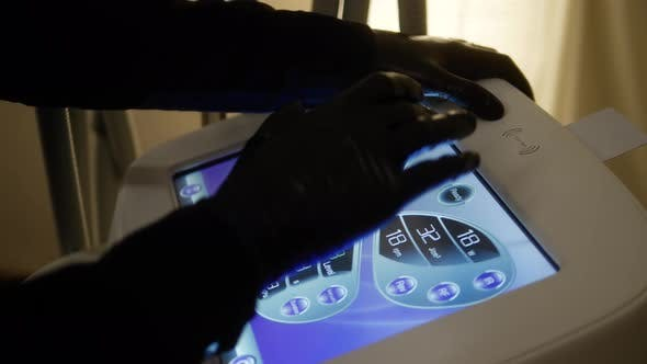 Thumbnail for Lpg Massage Procedure Doctor with Touch Screen Panel Touchscreen. Hands of Therapist Holding
