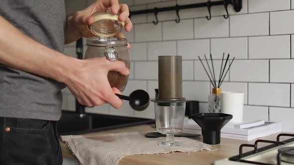 Barista Makes Aeropress Step By Step. Beginning Of The Process.