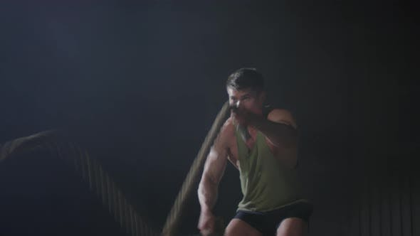 Thumbnail for Motivated Man Training with Battle Ropes