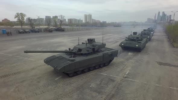 Thumbnail for Aerial Shot of Tanks in Columns Setting Off From Military Base, Russia