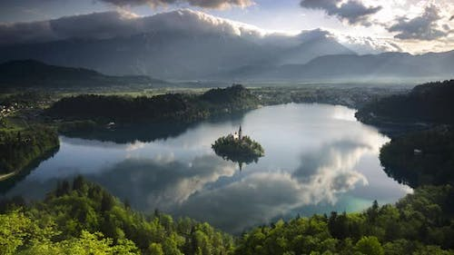 Lake Bled island landscape timelapse in Slovenia. Time lapse of clouds over Julian Alps Mountains Ra