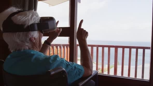Woman using virtual reality headset at home 4k
