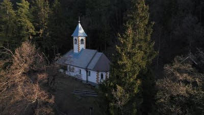 Hidden church in the forest on the hill