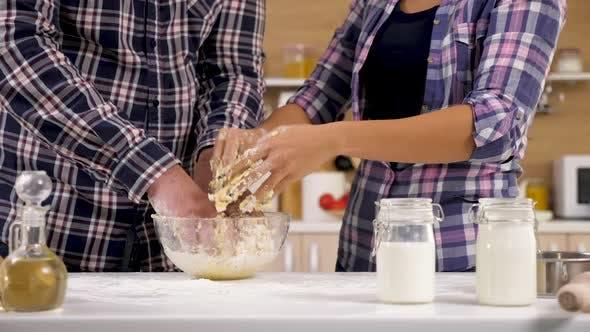 Hands Preparing Dough For Baking
