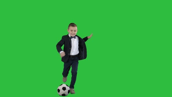Thumbnail for A cute boy in formal suit hitting a ball on a Green Screen