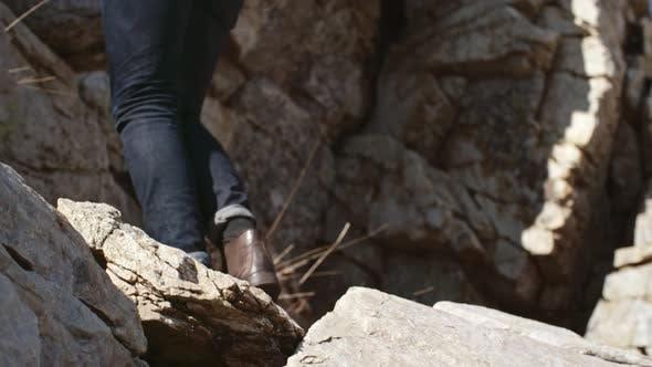Thumbnail for Man Climbing Mountains