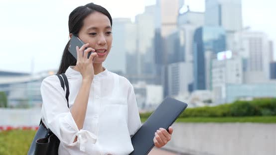 Thumbnail for Businesswoman talk to phone and hold with notebook computer