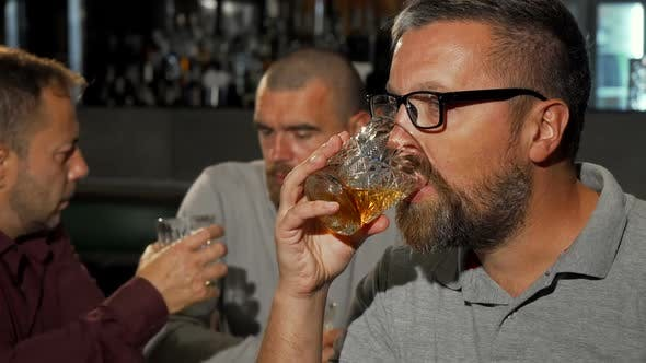 Thumbnail for Bearded Mature Man Smiling To the Camera After Tasting Delicious Whiskey