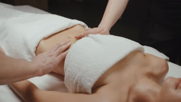 Thumbnail for Slim Brunette Woman Relaxing Receiving Health Body Rejuvenating Massage Procedure in Spa Center