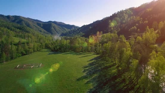 Thumbnail for Mid Air Flight Over Fresh Mountain River and Meadow at Sunny Summer Morning