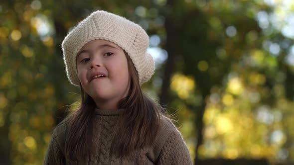Thumbnail for Portrait of Happy Girl with Down Syndrome Outdoors