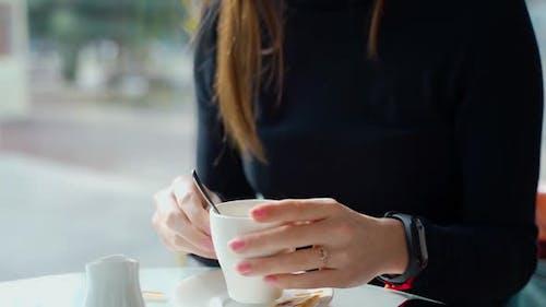 Woman in Coffee Shop