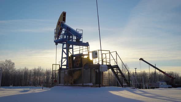 Thumbnail for Oil Production Plant Is Pumping Petroleum From Ground in Winter Day, Huge Industrial Equipment
