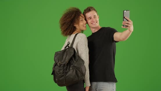 Thumbnail for Millennial couple take selfie on green screen