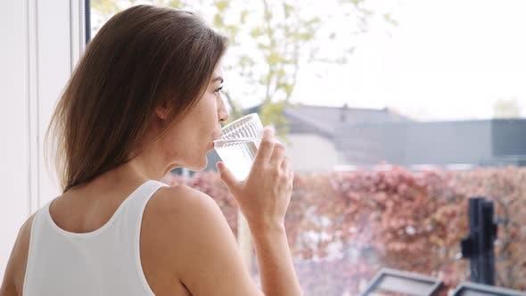 Woman Enjoying Glass of Water