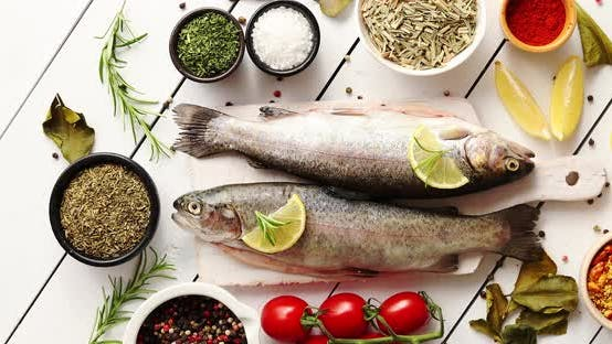 Aromatic Spices and Vegetables Around Fish