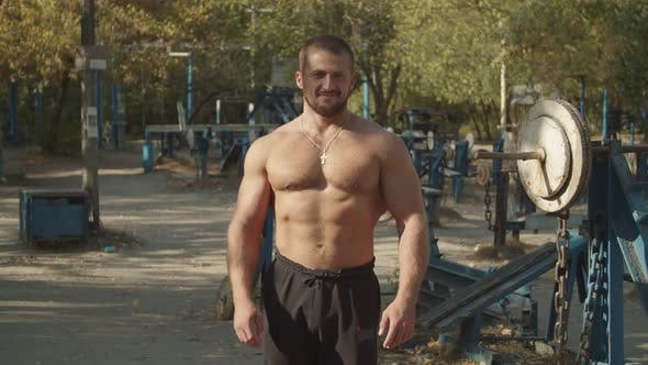 Thumbnail for Shirtless Muscular Man Playing Chest Muscles