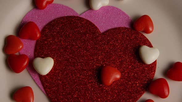 Rotating stock footage shot of Valentines decorations and candies - VALENTINES 0104