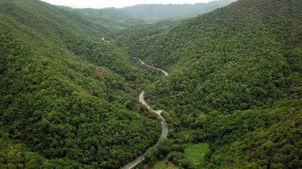 Aerial View Of Countryside Road Passing Through The Mountain Landscape 10