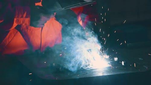 Metal Welder Working with Arc Welding Machine