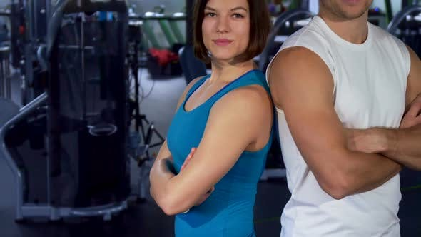 Cover Image for Fit Couple Shows Thumbs Up at the Gym