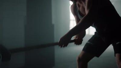 Powerful Athlete Exercising with Sledgehammer