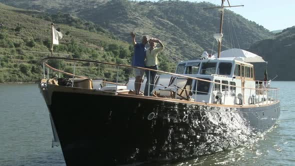 Thumbnail for Senior couple waving from a boat
