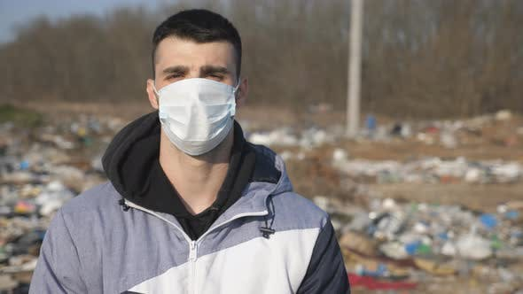 Thumbnail for Guy Wearing Protective Mask From Virus Outdoor. Portrait of Young Man with Medical Face Mask Stands