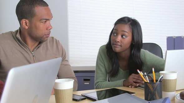 Thumbnail for Black business colleagues collaborating